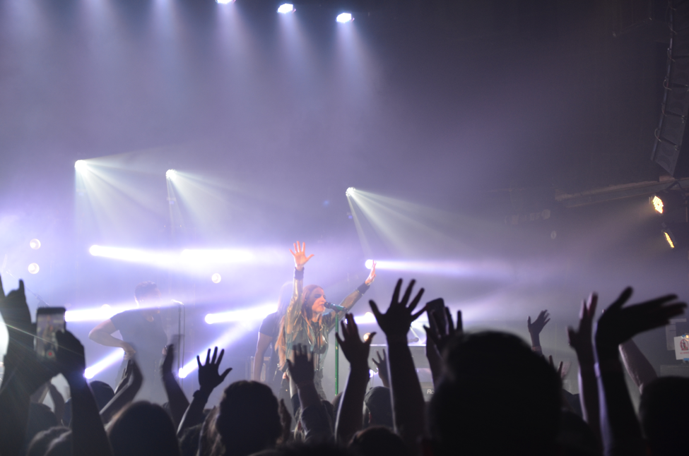 """JoJo brings the concert to a close with the title single off her album """"Mad Love"""". She unites the crowd by instructing them to raise both hands in the air."""