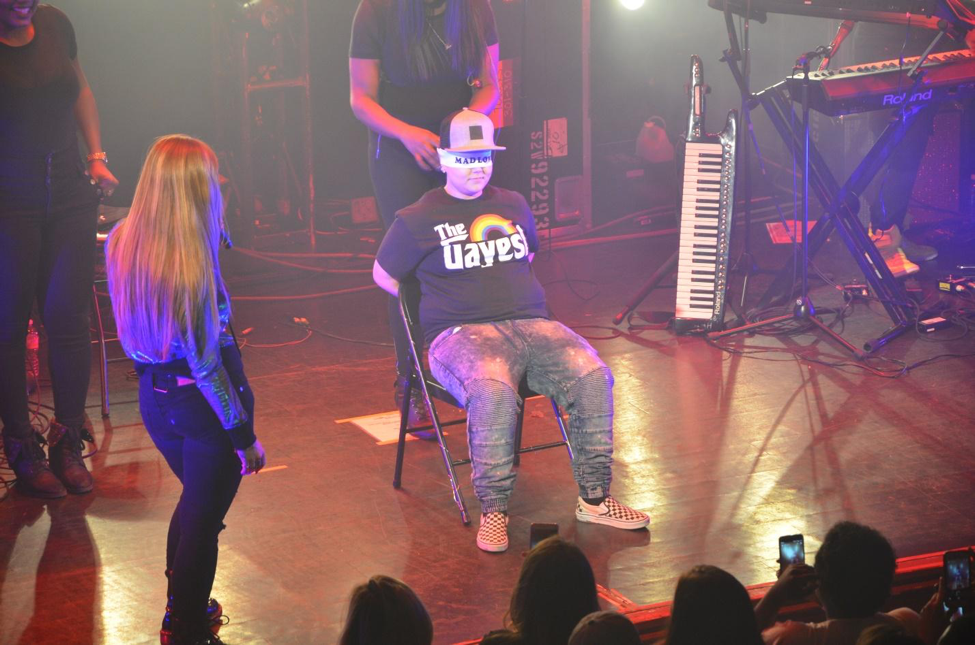 """A lucky fan is brought on stage and blindfolded while being serenaded to JoJo's hit song """"High Heels"""". This performance brought a change of atmosphere to the concert as it shifted from slow acoustic to high energy songs."""