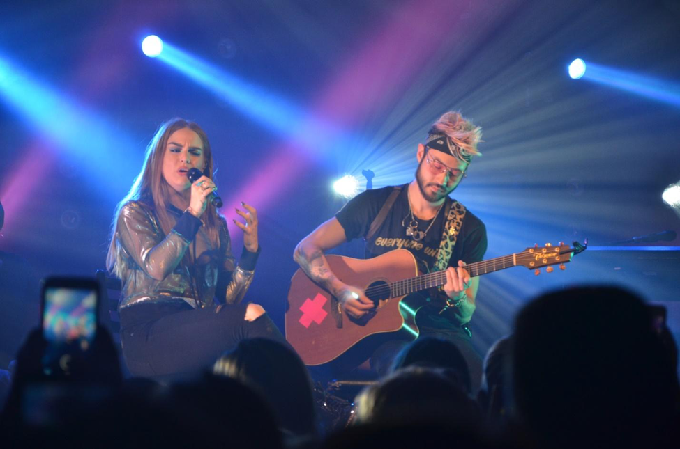 "JoJo, left, and guitarist Kenji Chan, right, slow the concert down with acoustic performances of ""Disaster"", ""We Get By"", and ""Marvin's Room (Can't Do Better)""."