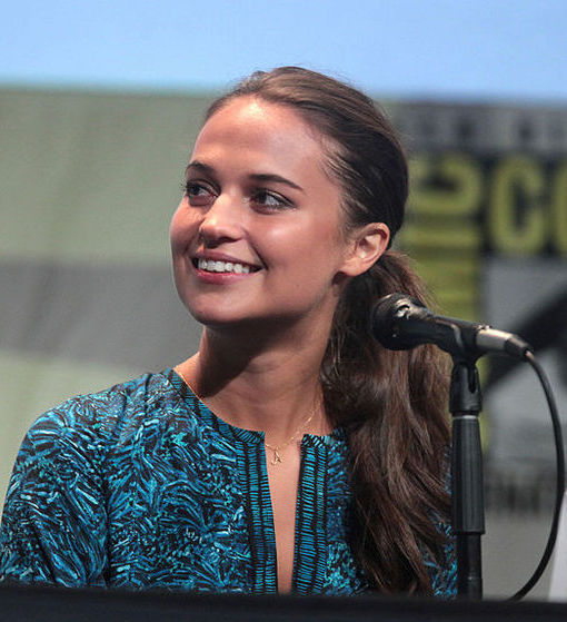 Alicia Vikander smiles on a 2015 Comic-Con panel.
