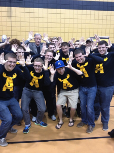 The Antlers doing the Antler pose with MU Head Coach Kim Anderson