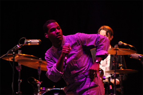 Leon Bridges dances on stage.