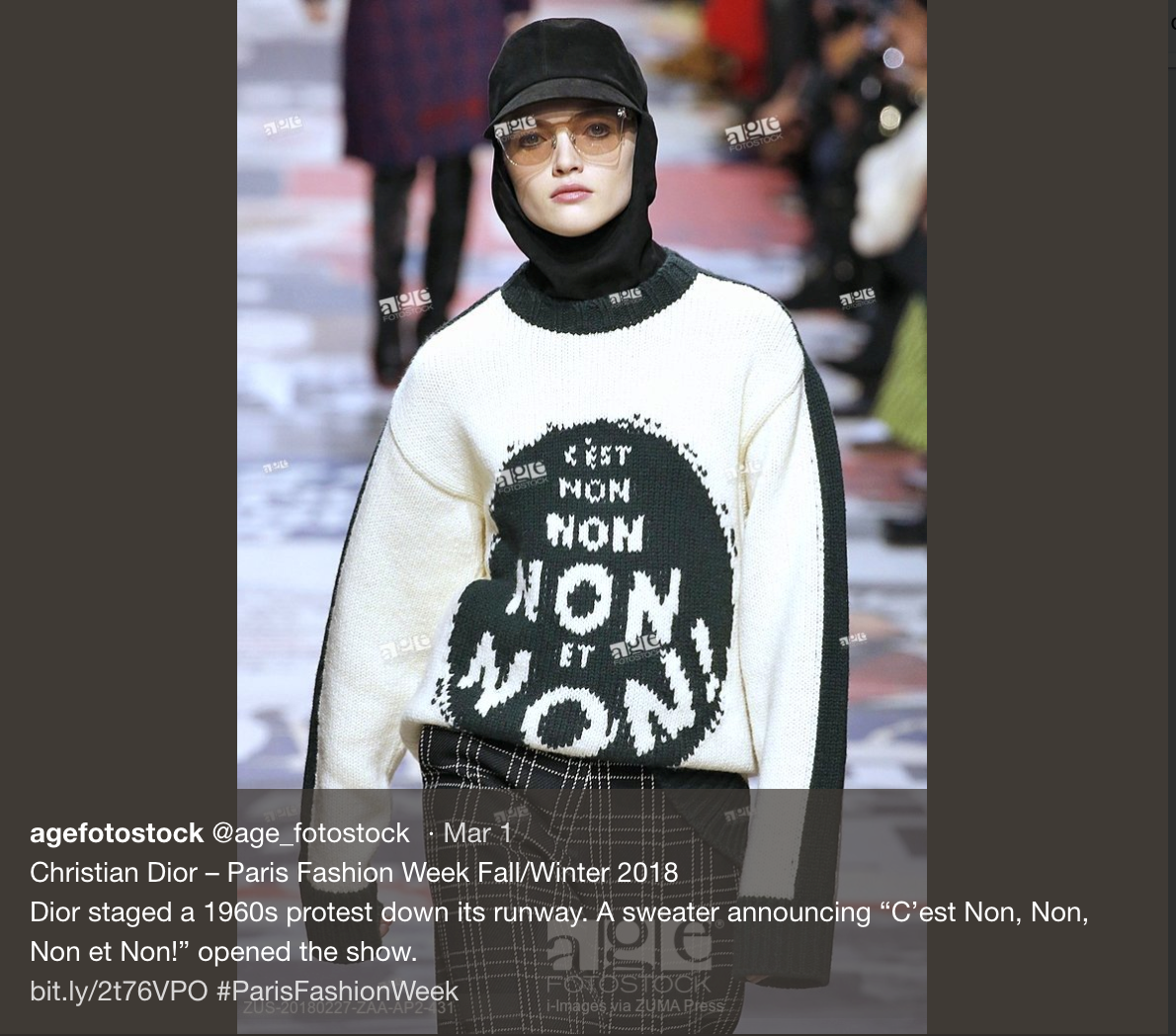 "A tweet showing a model at Dior's fashion show wearing a sweater that reads ""C'est Non, Non, Non et Non!"""