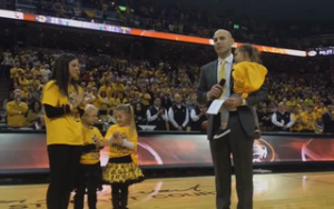 Mizzou assistant coach Brad Loos addresses the Rally for Rhyan crowd