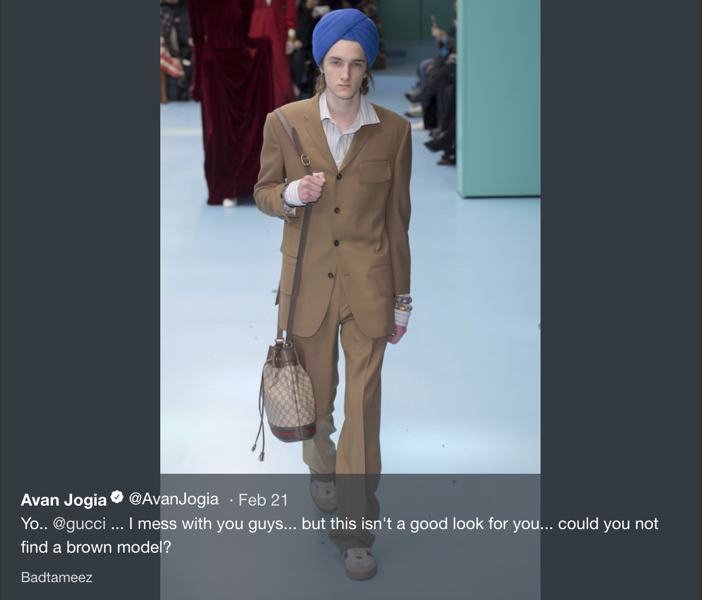 A white male model wears a turban at Milan Fashion Week.