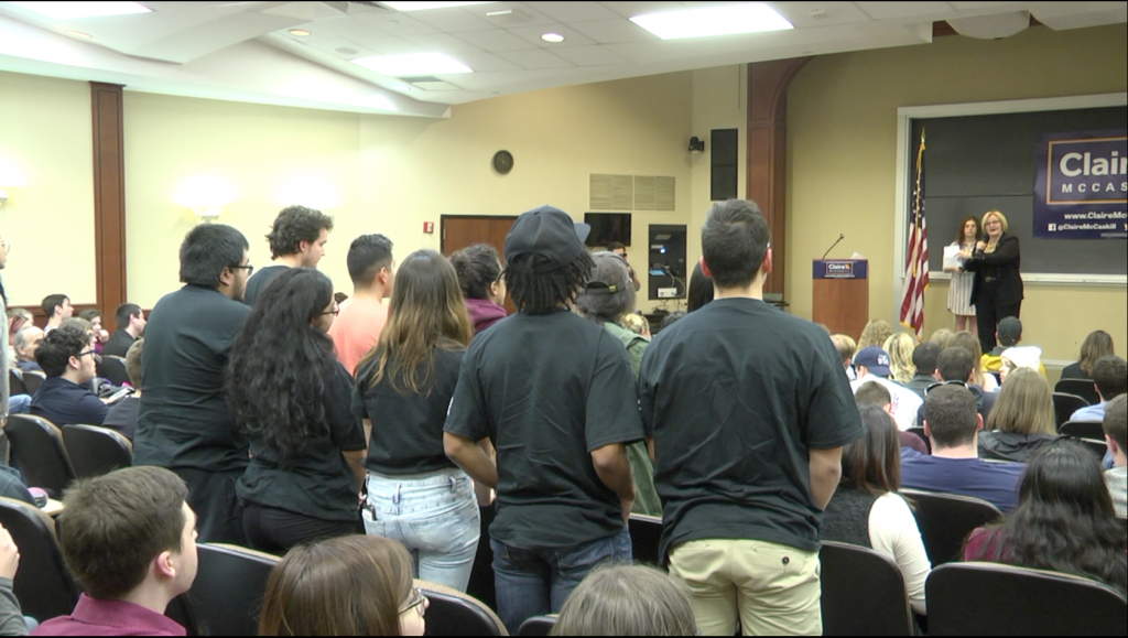 Students stand up in Jesse Wrench Auditorium as Sen. McCaskill speaks.
