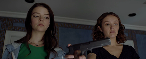 Lily holds a gun while Amanda stands at her side.