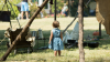 Little girl standing in encampment recreation